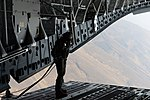 A loadmaster with the No. 36 Squadron RAAF, makes his way to the end of a C-17 Globemaster III's ramp.jpg