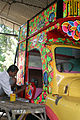 A truck being painted near Cochin, India.jpg