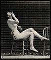 A woman sitting naked on a chair and smoking. Collotype Wellcome V0048657.jpg