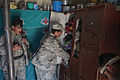 Afghan Border Police officers search for contraband in a compound in Bets Kalay village, Kandahar province, Afghanistan, Feb 120228-A-EW551-167.jpg