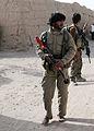 Afghan and coalition forces patrol western Kandahar village DVIDS545423.jpg