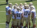 Aggies in huddle at UC Davis at Cal 2010-09-04 2.JPG