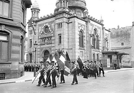 A Nazi parade by the Synagogue in Luxembourg in 1941. It was destroyed in 1943. Al SynagogueLux Nazidefile.jpg