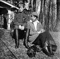 Alexei, Tatiana and her French Bulldog Ortino in the Park at Tsarskoe Selo.jpg