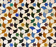 Colourful geometric tiling in the Alhambra, Spain