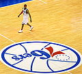 Allen Iverson and the Sixers logo.jpg