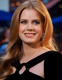 A photograph of Amy Adams as she smiles at the camera