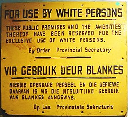 https://upload.wikimedia.org/wikipedia/commons/thumb/1/12/ApartheidSignEnglishAfrikaans.jpg/262px-ApartheidSignEnglishAfrikaans.jpg