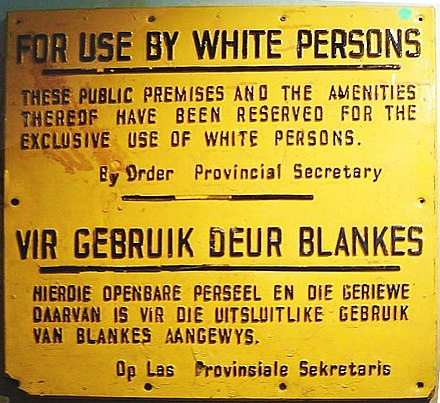 """For use by white persons"" - apartheid sign in English and Afrikaans ApartheidSignEnglishAfrikaans.jpg"