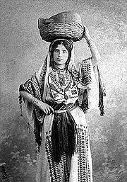 Arab woman from Ramallah wearing traditional dress in 1915.