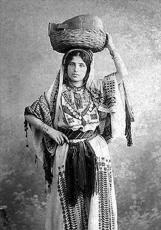 Khalil Raad - A photograph composed by Raad of a woman wearing the traditional Palestinian costume of Ramallah in 1920
