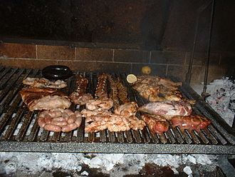 Asado - A typical Argentinean asado assortment consisting of beef, pork, ribs, pork ribs, chitterlings, sweetbread, sausages, blood sausages, and chicken.