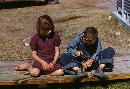Boy building a model airplane, Texas, 1942 (photograph by Arthur Rothstein for the Farm Security Administration) Arthur Rothstein, Boy building a model airplane as girl watches, FSA camp, Robstown, Texas, 1942.jpg