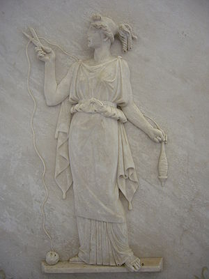 Atropos - Bas relief of Atropos, shears in hand, cutting the thread of life