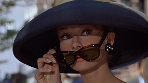 Oliver Goldsmith (company) - Audrey Hepburn in Breakfast at Tiffany's wearing a pair of Oliver Goldsmith 'Manhattan' sunglasses, 1961