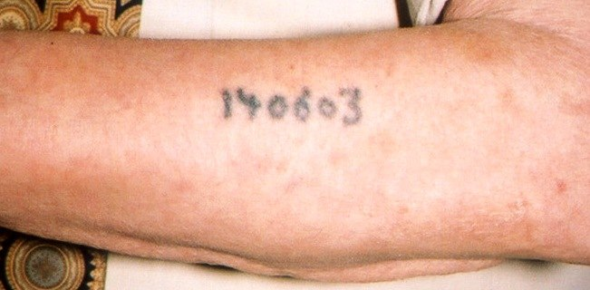 Auschwitz survivor displays tattoo detail