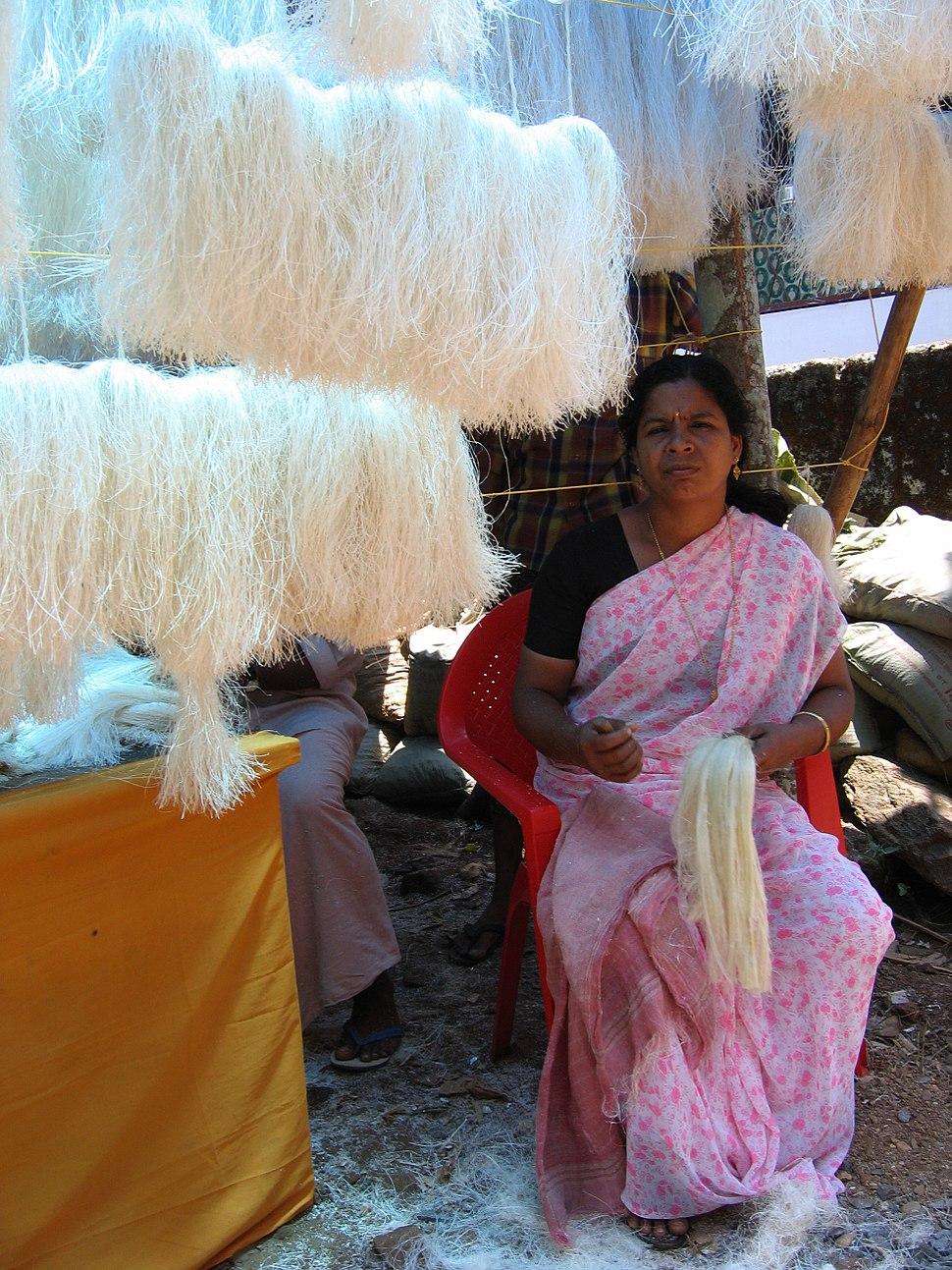 Bamboo flower maker at her shop at Kottiyoor