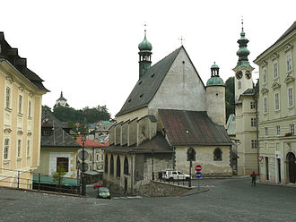"Banská Štiavnica - The town viewed from the Trinity square with the ""New Castle"" left, St. Catherine´s church from 1491 in the middle"