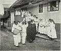 Belokranjski običaji - Prihod ženinih svatov pred nevestin dom 1914.jpg