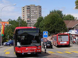 Ostermundigen - Biogas buses with an apartment tower in Ostermundigen