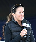 Brandi Chastain holding a microphone with an ESPN logo