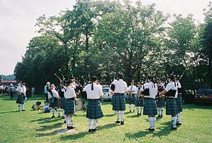 Bridge of Allan - Pipe band practicing at the Strathallan Games in 2004.