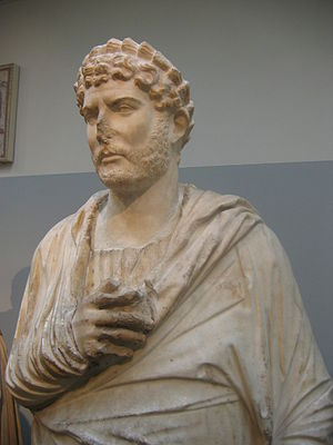 Roman emperor Hadrian in Greek dress offers a ...