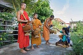 Buddhist alms in Si Phan Don.jpg