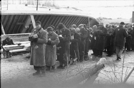 Jewish prisoners are issued food on a building site at Salaspils concentration camp, Latvia, in 1941.(Nazi propaganda photo) Bundesarchiv Bild 101III-Duerr-053-29, Lettland, KZ Salaspils, Essensausgabe.jpg
