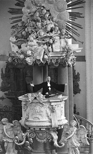 F. K. Otto Dibelius -  Otto Dibelius preaching from the pulpit (1703 by Andreas Schlüter) in St. Mary's Church, Berlin (East), 1959