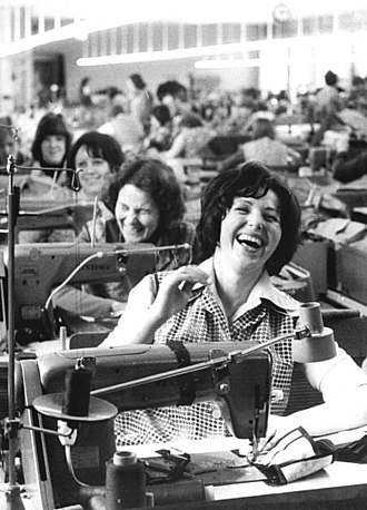 Laughter - Workers laughing in a clothing factory.