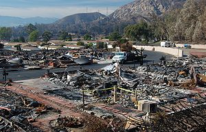 Sayre Fire - The remains of the Oakridge mobile home park in Sylmar. 480 of the park's 600 mobile homes were burned in the fire. The undamaged houses in the background became uninhabitable due to lack of utility service.