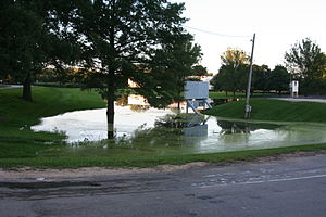 The Rock River having flooded into a business ...