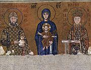 Twelfth century mosaic from the upper gallery of the Hagia Sophia, Constantinople. Emperor John II (1118–1143) is shown on the left, with the Virgin Mary and infant Jesus in the centre, and John's consort Empress Irene on the right.