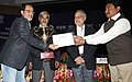 """C.P. Joshi and the Minister of State for Road Transport and Highways, Shri Tusharbhai Chaudhary presented the Trophy to the President Ekjut Sansthan, Jaipur, Rajasthan, at the """"13th Meeting of National Road Safety Council"""".jpg"""