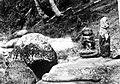 COLLECTIE TROPENMUSEUM Stenen beelden en reliëfs tussen grote stenen in Noord-Sumatra TMnr 10000891.jpg
