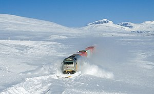 Snow - Norwegian train plowing through drifted snow