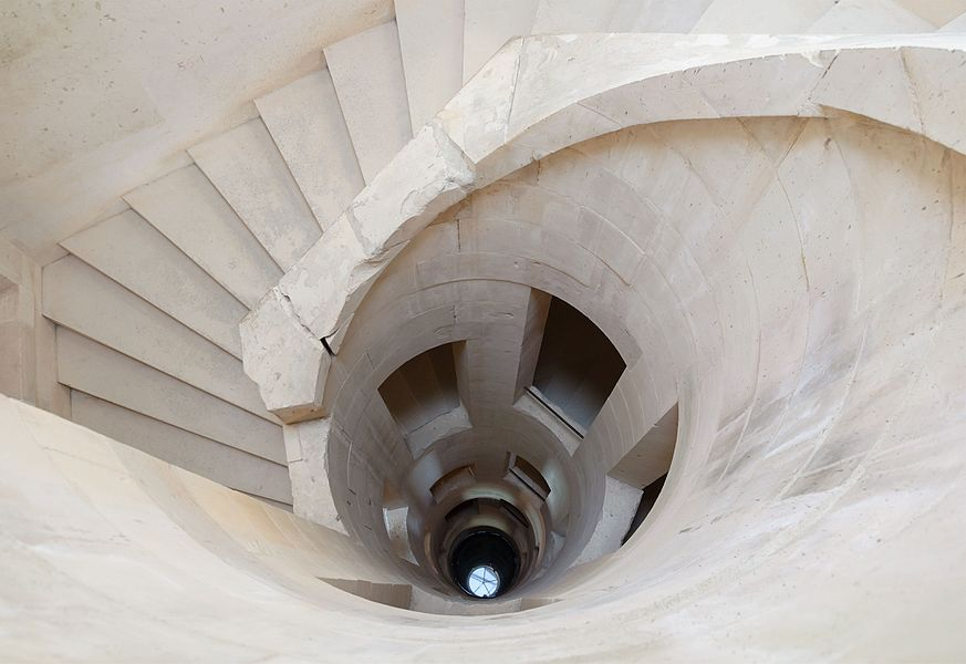 Château de Maulnes in Cruzy-le-Châtel, Burgundy, France: the central helical stairs around the well, also used as a skylight.