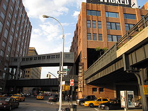 High Line - The High Line Park between 14th and 15th streets where the tracks run through the second floor of the Chelsea Market building, with a side track and pedestrian bridge