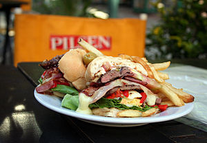 Chivito (sandwich) - A Chivito sandwich, with all the trimmings