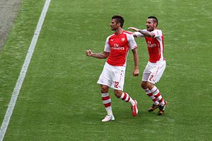 Mathieu Debuchy - Debuchy on his Arsenal debut in the 2014 FA Community Shield, celebrating Olivier Giroud's goal