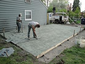 Concrete Being Stamped With An Ashlar Slate Pattern