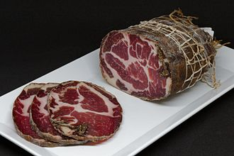 Capocollo - A piece of Coppa Spécialité Corse (Corsica). A balanced quantity of white fat is important for flavour and softness.
