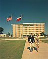 Couple walking in front of University of Texas at Arlington's new 6 floor Library (10003725).jpg