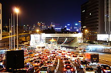 Tunnel entrance at night, with heavy traffic