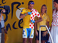 Cyril Dessel putting on the combined yellow jersey and polka dot jersey (Tour de France 2006).jpg