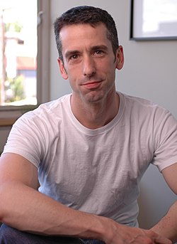 Man facing front wearing white t-shirt