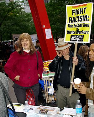 Workers World Party - Members staffing a WWP information booth at Occupy Wall Street, October 2011