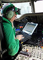 Defense.gov News Photo 120310-N-BL924-002 - Petty Officer 1st Class Charles Cisneros performs diagnostic checks on the mission systems of an MH-60R Sea Hawk helicopter assigned to Helicopter.jpg