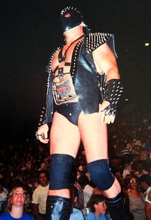 Demolition (professional wrestling) - Demolition was known for their distinctive outfits which involved an entrance mask as well as red and silver face paint.